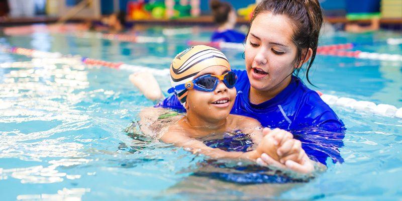 swim student and instructor practicing swim strokes